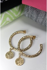 Gold hoops with charm